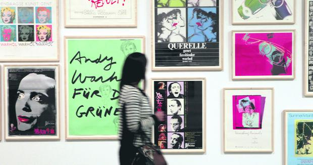 Art fans enjoy getting the first glimpse at the first ever major exhibition of Andy Warhols work at the MAC Belfast.