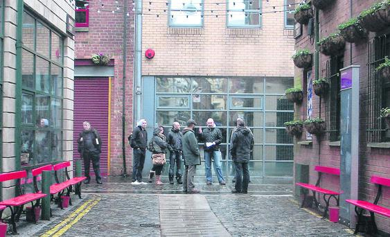 Tourists taking part in DC Tours' A History of Terror walk in downtown Belfast this week