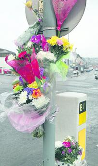 Flowers are left in memory of Philippa Reynolds, who died in a collision at the weekend