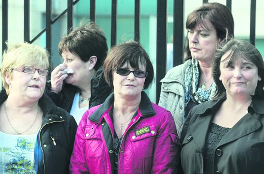 Eileen Doherty's family leave Belfast Crown Court today after seeing killer Robert Rodgers jailed for life for the 1973 sectarian murder