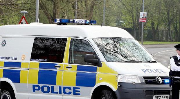 Two men are being questioned after a stolen car crashed into a police car in Belfast