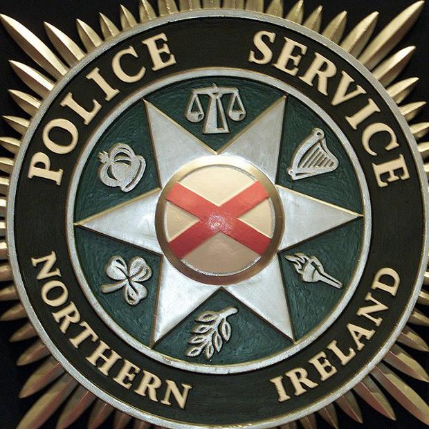 PSNI officers were attacked after they attempted to break up a protest at the north Belfast derby football match between Cliftonville and Crusaders