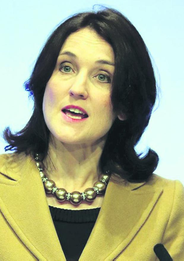 Secretary of State Theresa Villiers has called for an end to the flag protests