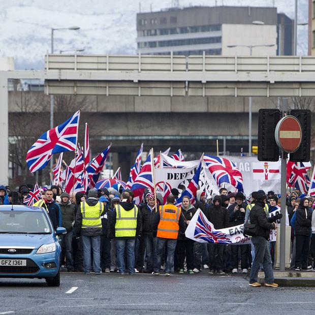 Loyalist protesters return to east Belfast after a flag protest in the city centre