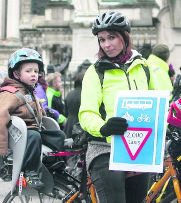 Cyclists protesting yesterday at Belfast City Hall over plans to open up bus lanes to all taxis