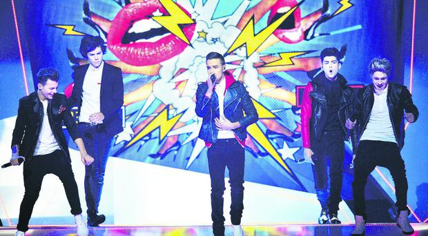 One Direction perform their Comic Relief single on stage during the Brit Awards on Wednesday night