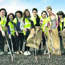 Campaigning: enthusiastic volunteers join in The Big Spring Clean at Ballyholme beach in Bangor