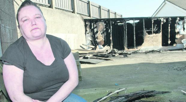 Andrena Wilson and her burnt-out shed