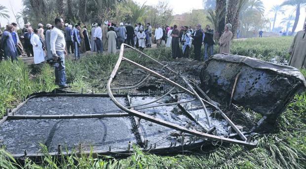Egyptians gather at the site of a balloon crash