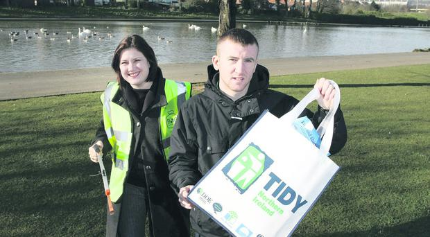 Olympic medal winning boxer Paddy Barnes pictured along with the Belfast Telegraph's Linda Stewart in North Belfast's Waterworks Park to launch The Big Spring Clean