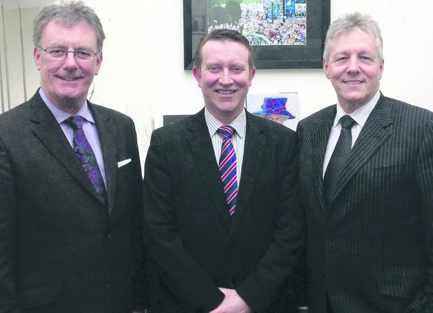Eric Lutton (centre) with Ulster Unionist Party leader Mike Nesbitt and First Minister Peter Robinson