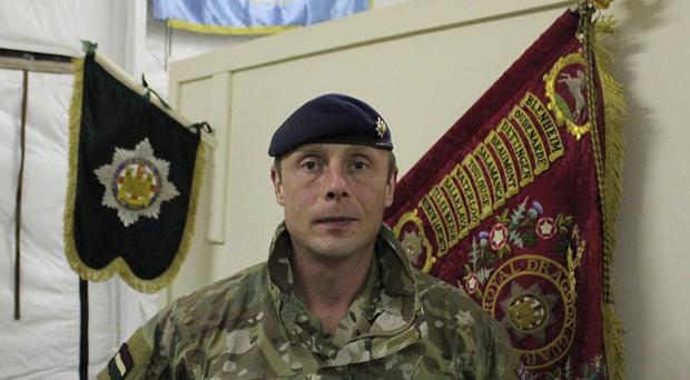 Lieutenant Colonel Jamie Piggott, Commanding Officer of Royal Dragoon Guards who are serving in Afghanistan. PRESS ASSOCIATION Photo. Issue date: Sunday March 3, 2013. Northern Ireland's contentious marching season could provide perfect training opportunities for Afghan police officers, the senior soldier has said. See PA story ULSTER Afghanistan. Photo credit should read: Lesley-Anne McKeown/PA Wire