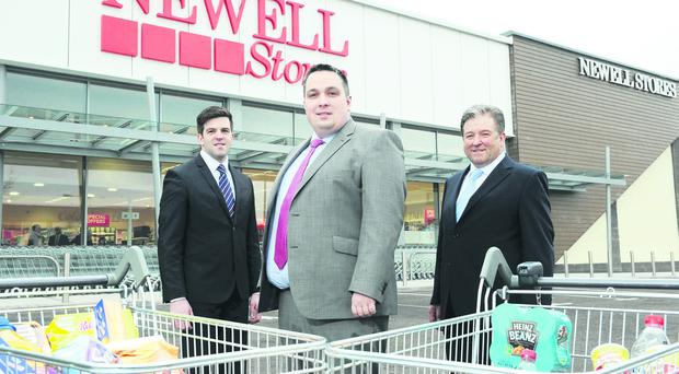 Aaron Ennis, Danske Bank corporate banking manager (centre) with Colin and Eugene Conway of Newell Stores at the opening of the Coalisland venture
