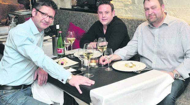 Joris Minne (left) enjoys dinner with Glenn Waddell and Nick Acheson at the Boat House, Bangor. Nick won Joris's job as Belfast Telegraph restaurant critic for a day in a NI Hospice fundraising raffle