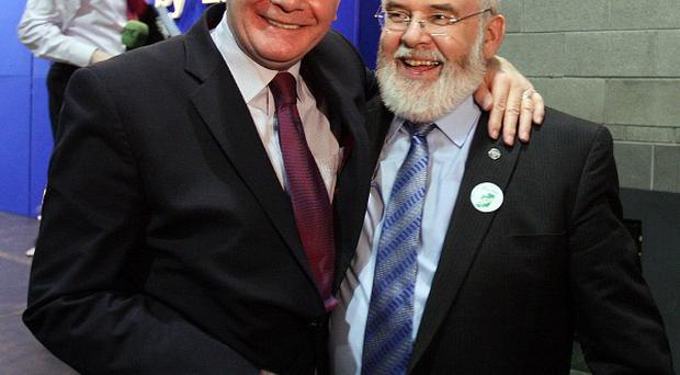 Outgoing MP Martin McGuinness congratulates Sinn Fein candidate Francie Molloy after he was elected MP for Mid Ulster