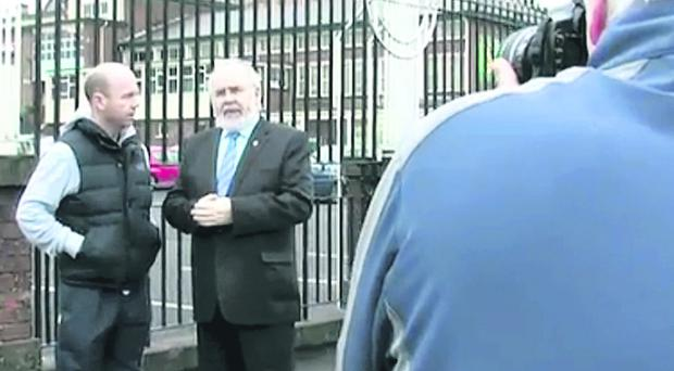 Francie Molloy and Peter Canavan ouside Holy Trinity College in Cookstown