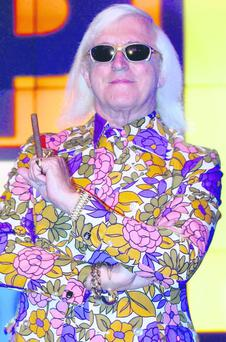 Sir Jimmy Savile during a Top of the Pops photocall