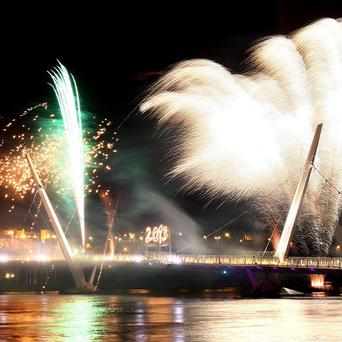 Fireworks over the Peace Bridge as Derry-Londonderry celebrates becoming the UK's 2013 city of culture