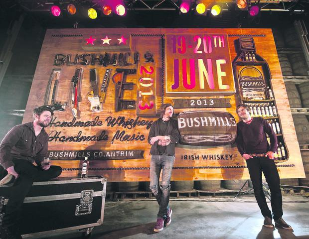 Gareth Martin, Sean Johnstone and Barry Caddell with their 3D art installation that depicts the Bushmills Live poster using materials inspired by the whiskey and music at the heart of the festival