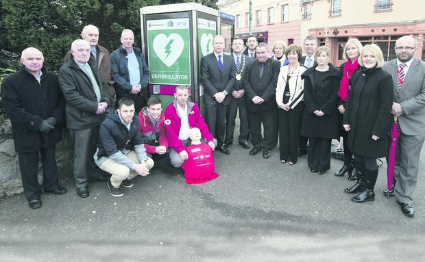 Eighteen of the Crossgar residents who are trained to use the new defibrillator
