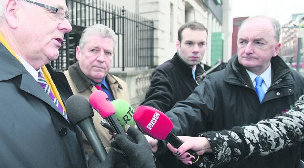 Omagh bomb victims' relatives Michael Gallagher and Stanley McCombe leave Belfast High Court