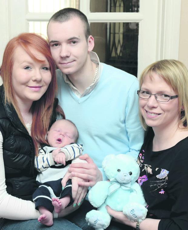 Baby Jackson with mum Louise Martin and dad Aaron Moore with their Family Nurse, Roisin Neill.