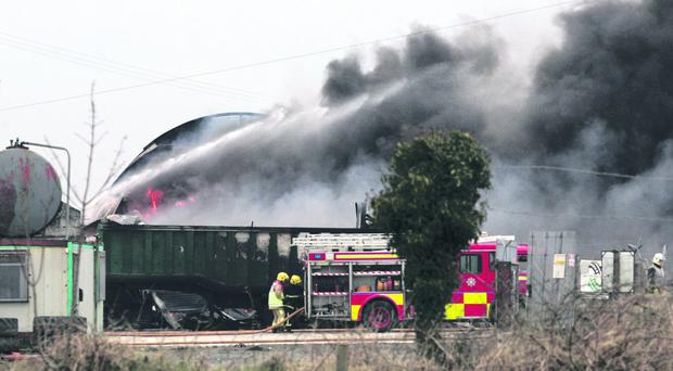 Fire fighters tackle a blaze an an industrial factory in Maybridge in South Armagh