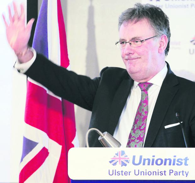 Challenges: UUP leader Mike Nesbitt waves to the audience at his party's annual general meeting