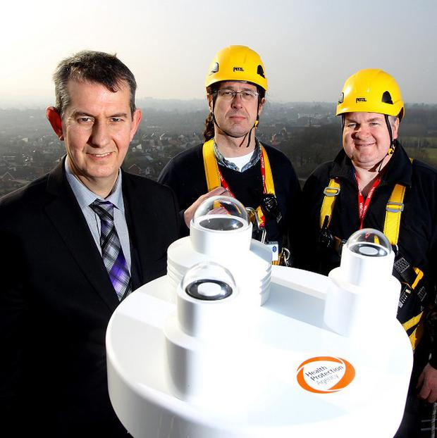 From left, Edwin Poots, Andy Pearson and Phil Miles from the HPA at the installation of a UV radiation monitor on the roof of Dundonald House (Health Protection Agency/PA)