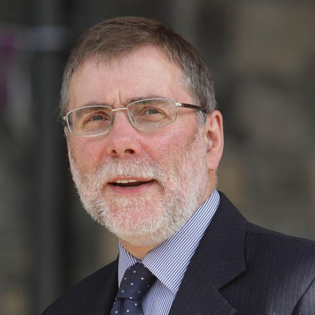 Housing Minister Nelson McCausland branded the overpayment a scandal and said an investigation had been launched