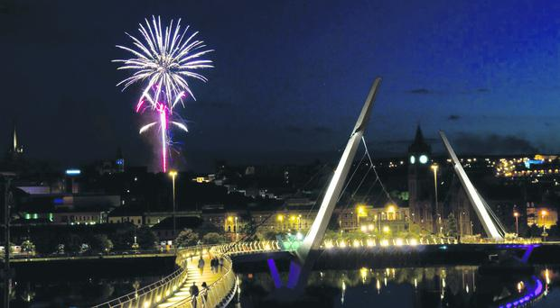 Fireworks light up the sky over the Peace Bridge in Derry~Londonderry following a childrens party in the Apprentice Boys Memorial Hall which was part of the Maiden City Festival which continues this week. Picture Martin McKeown. Inpresspics.com. 7.8.12