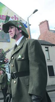 A marcher takes part in the annual Easter parade on the Falls Road, Belfast