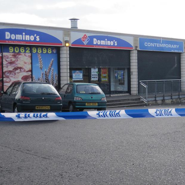 The scene of the shooting, outside Domino's Pizza in west Belfast