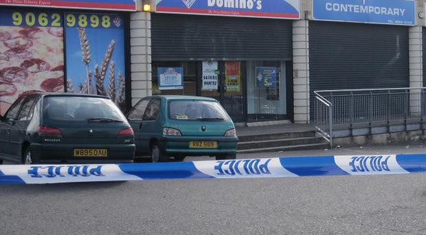The area outside Domino's Pizza in the Turf Lodge area in the west of Belfast where pizza delivery Kieran McManus driver was killed