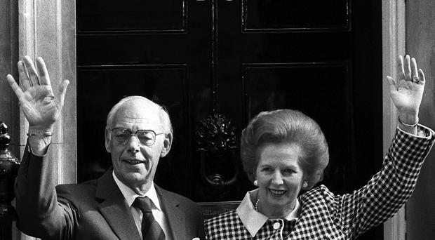 Prime Minister Margaret Thatcher and her husband Denis on the doorstep of 10 Downing Street, London, in 1989, 10 years after they moved in