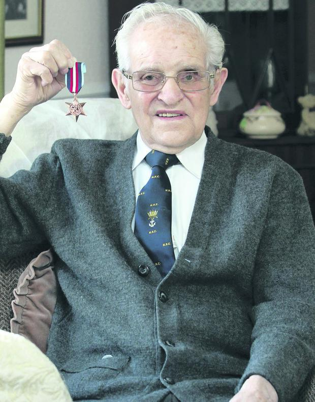 Tommy Jess, 90 year old war veteran at his home with his war medal.