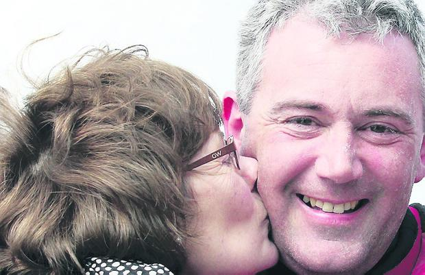 John Lynn, gets a peck from mum Aileen after his sailing from Islay to Portrush in memory of his late dad Robert