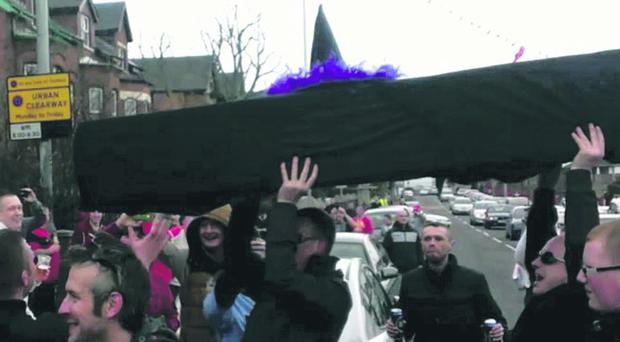 Own goal: Cliftonville fans carry a black coffin with a witch's hat on the top to the Cliftonville v Linfield league decider at Solitude on Saturday.