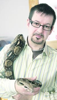 David Thompson shows off some of the family's exotic pets