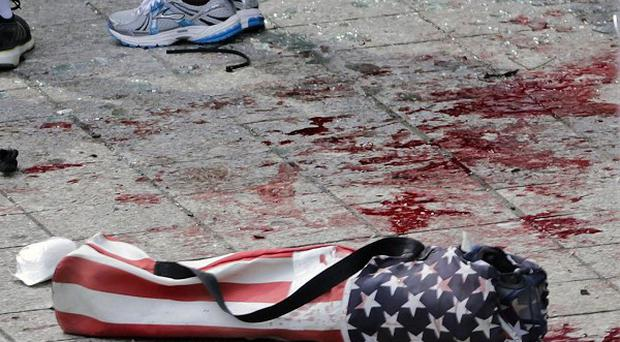 Three people were killed and more than 100 injured in two bomb attacks at the Boston Marathon