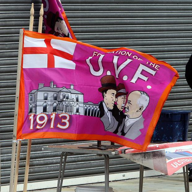 Symbols: UVF flags on Belmont Road (not related to a prescribed organisation)