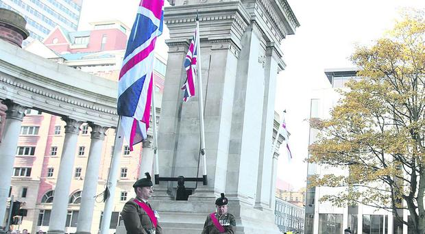 The Union flag flying at the cenotaph in the grounds of Belfast City Hall last November