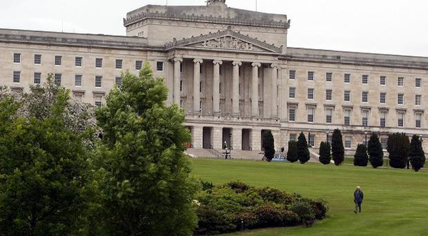 Five Stormont security guards face an inquiry after an off-duty police officer entered Parliament Buildings with a gun