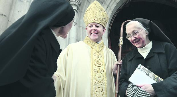 Eamon Martin greets two nuns at St. Patrick's Cathedral, Armagh