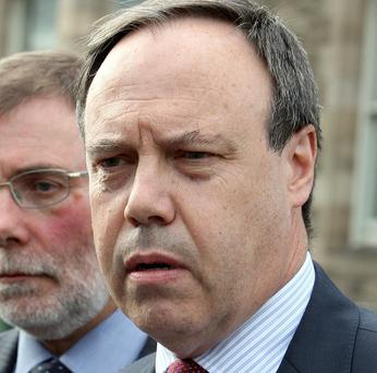 Nigel Dodds, right, was taken ill at Westminster