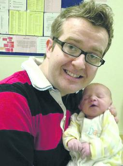 David Meade and new baby George.
