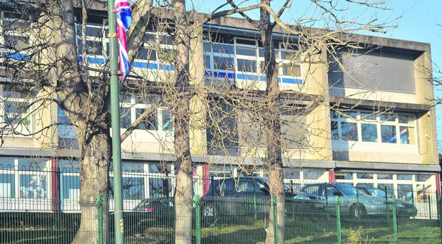 Union flags outside the catholic Holy Cross Primary School in north Belfast.