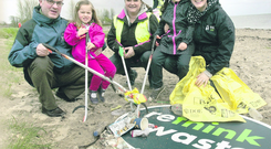 Enviroment Minister Alex Attwood with his daughters Anna and Nora, with Wendy Loughridge,(centre) Manager Mark & Spencers Abbey Centre and Lynsey McCloskey, Tidy NI during the Tidy NI Big Spring Clean in conjunction with Marks & Spencers at the Loughshore Park, Jordanstown.