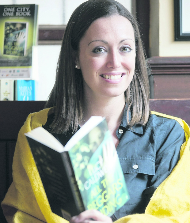 Read all about it: Author Lucy Caldwell pictured with her latest novel All the Beggars Riding - the One City One Book Belfast choice for 2013