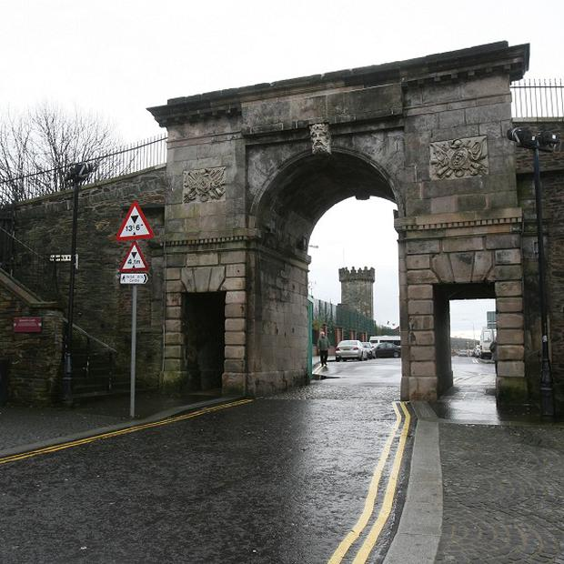 Work has started to remove security gates at the top of Derry's walls